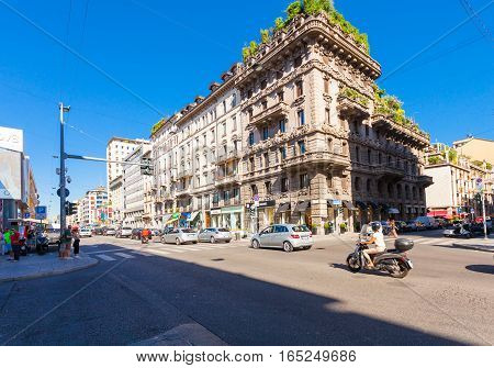 MILAN ITALY - September 06 2016: Pedestrian crossing(crosswalk) car and tram driving on the Avenue Buenos Aires (Corso Buenos Aires)