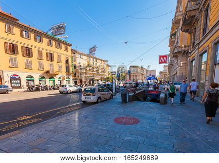 MILAN ITALY - September 06 2016: People are walking on the sidewalk near the metro station P.ta Venezia located on the Avenue Buenos Aires (Corso Buenos Aires)