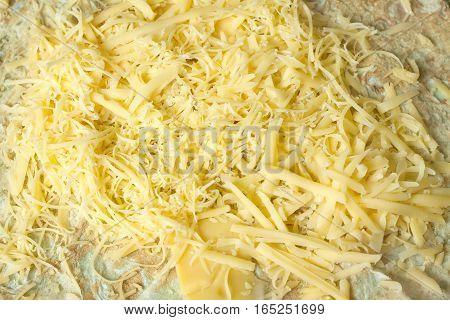 Appetizing pita ground and sliced cheese horizontal view closeup