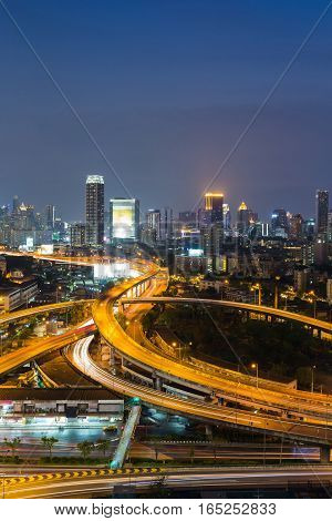 Night light city highway intersection with city office background