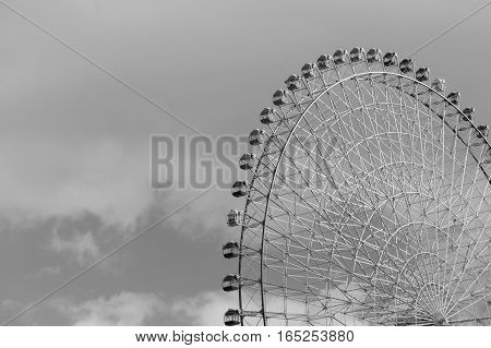 Black and White path of large observation Ferris Wheel close up