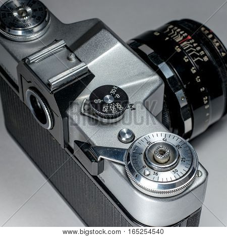 Gatchina, Russia - January 15, 2017: The old Soviet film camera Zenit. Photographed on a bright background. Detail close-up camera.