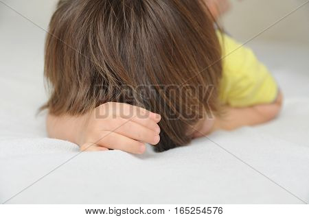 Child Hiding Face Lying On Bed, Crying  Offended Little Girl