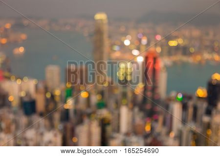 Aerial view blurred lights Hong Kong city business downtown over Victoria Bay