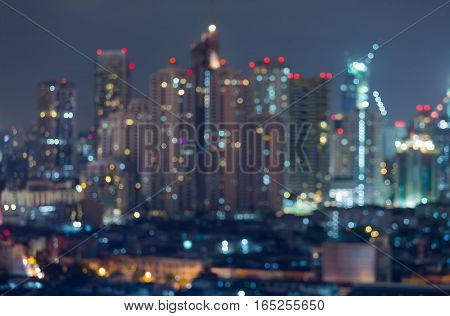 Blurred bokeh lights office building night view abstract background