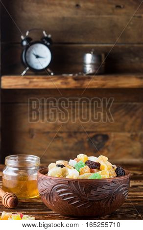 Candied And Dried Fruits In A Bowl On A Wooden Table. A Rustic Style. Selective Focus