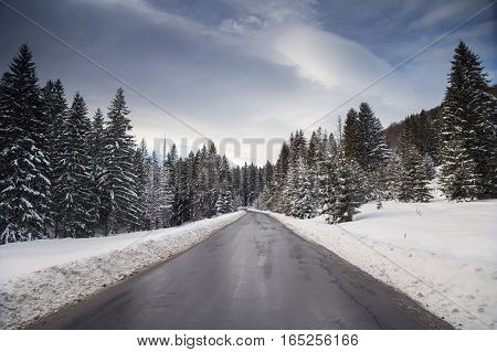 Beautiful mountain road in winter, in transylvanian mountains