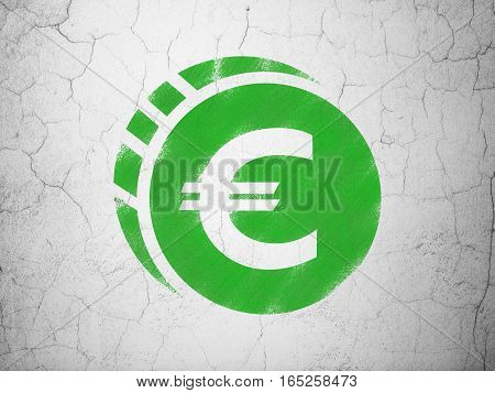 Currency concept: Green Euro Coin on textured concrete wall background