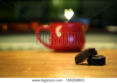 Valentine's day concept with red cup and hearts over
