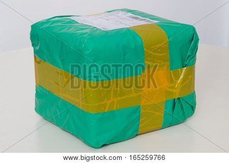 International Parcel wrapped by duct tape. On white