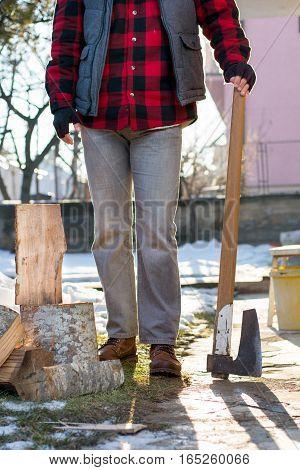 Man Holding An Axe For Chopping Firewood