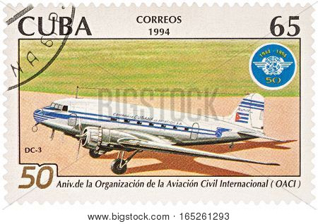 MOSCOW RUSSIA - January 15 2017: A stamp printed in Cuba shows aircraft DC-3 and emblem of ICAO series