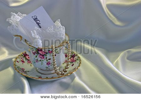 Cup, Saucer, Linen Handkerchief and Pearls