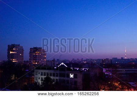 Chisinau city in the evening with a purple sunset, view on tv station and crown plazza buildings in centre