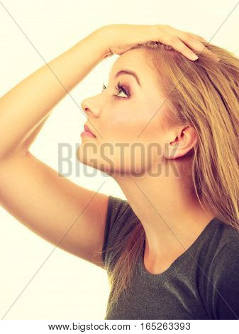Fresh haircut hairstyling haircare concept. Woman holding hand on her blonde hair.