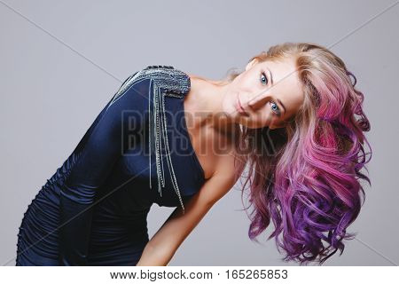 Colored hairstyle. Portrait of smiling women with big blue eyes. Ombre. Gradient Studio