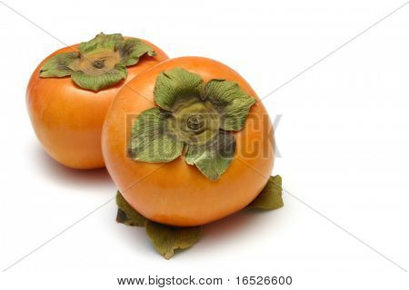 Persimmons or Fuyu fruit isolated on white