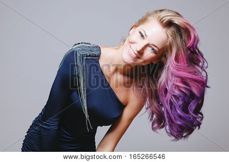 Colored hairstyle. Portrait of smiling women with big blue eyes. Ombre. Gradient. Studio
