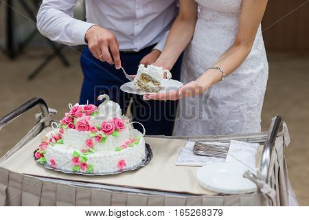top of wedding cake decorated with flowers. couple knife cake