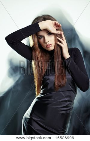 Young woman wearing gorgeous black dress