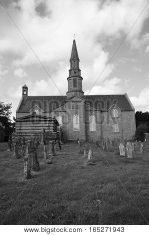 A view across the graveyard to the church at Methven