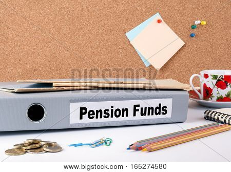 Pension Funds. Folder on office desk. Money, Coffee Mug and colored pencils.
