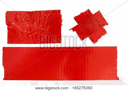 Set of used red duct tape pieces