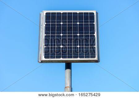 image of solar panels against a blue sky