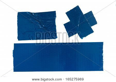 Set of used blue duct tape pieces
