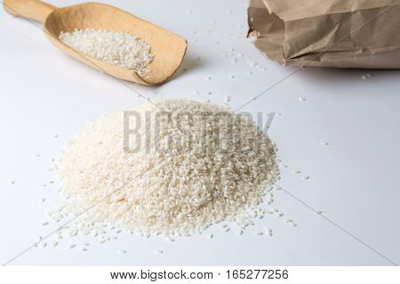 Rice, Wooden Spoon And Big Paper Bag