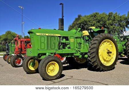 YANKTON, SOUTH DAKOTA, August 19, 2106: A restored vintage john Deere 3020 tractor is displayed at the annual Riverboat Days celebrated the third weekend of August