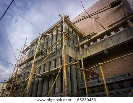 constructing a building using bamboo scaffolding photo taken in Jakarta Indonesia java