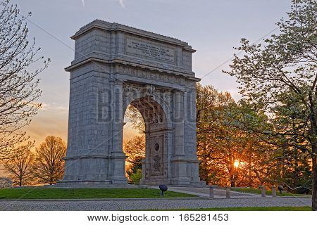 A springtime sunrise at Valley Forge National Historical Park in Pennsylvania USA.The National Memorial Arch is a monument dedicated to George Washington and the United States Continental Army.