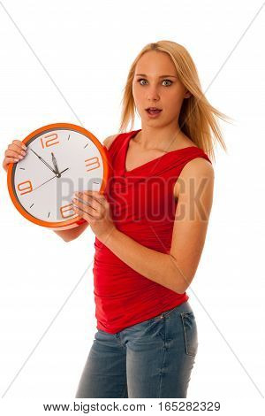 Blonde Business Woman In Red Shirt Holds Clock As Sign For Time Management