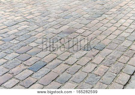 Cobblestone background street area texture close up