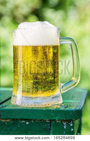 Fresh Beer In Sunny Day On Old Wooden Table
