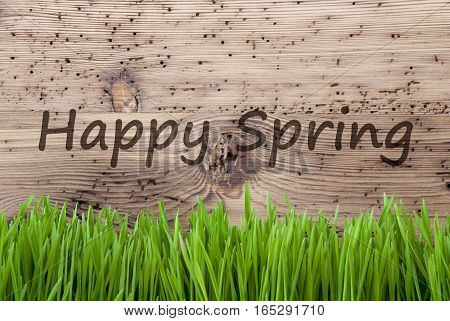 English Text Happy Spring. Season Greeting Card. Bright Aged Wooden Background With Gras.