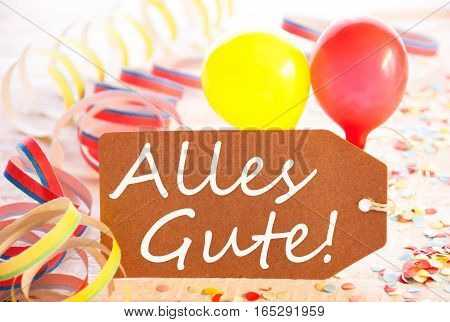 One Label With German Text Alles Gute Means Best Wishes. Party Decoration Like Streamer, Confetti And Balloons. Wooden Background With Vintage, Retro Or Rustic Syle
