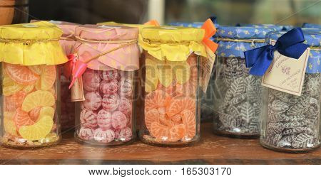 vintages jars of colorful candy for sale