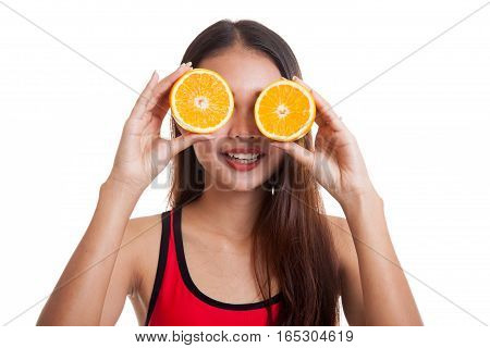 Beautiful Asian Healthy Girl With Orange Fruit Over Her Eyes.