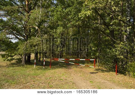 The barrier is lowered. on the nature of the road is closed