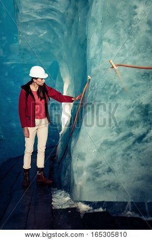 Scientist at an Expedition Site Examining a Glacier.