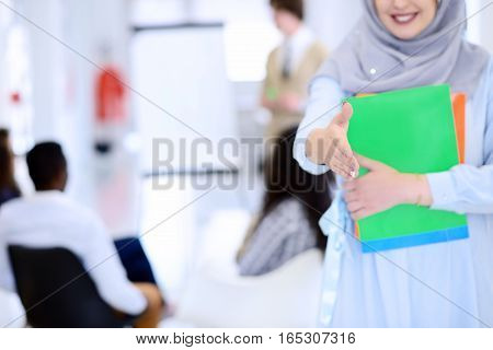Arabic business woman working in team with her colleagues at startup office.