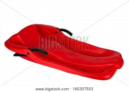 Plastic Red Sled For Skiing On White Background
