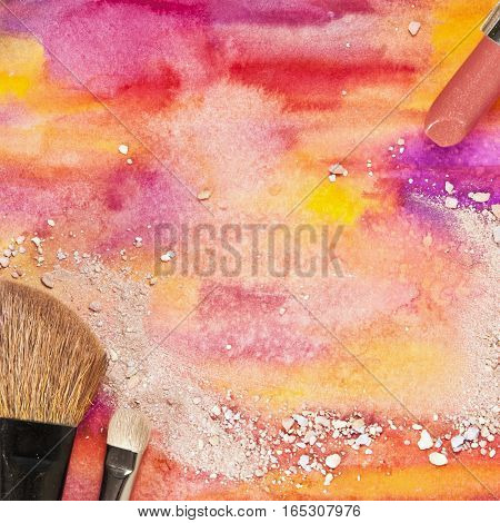 Makeup brushes and lipstick on a vibrant yellow and purple background, with traces of powder and blush. Square template for makeup artist's business card or flyer design, with plenty of copyspace