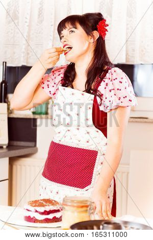 Photo of vintage-style dressed girl baking a cake