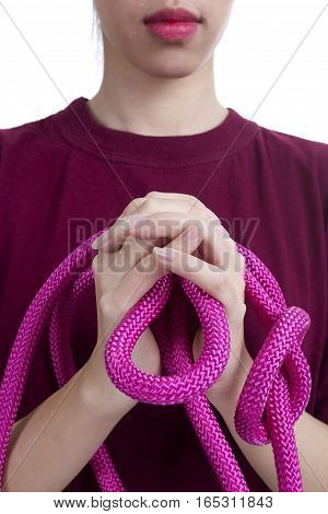 Raspberry rope in female hands on a white background