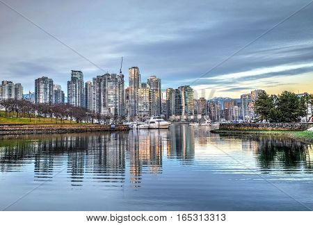 Sunset at city harbor. False Creek from Granville Island. Yaletown. Vancouver. British Columbica. Canada.