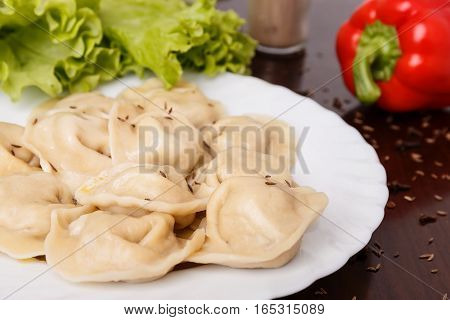 dumplings table red pepper lettuce lunch plate with food