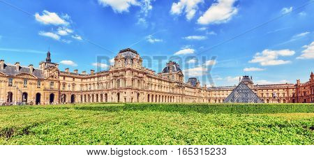 Paris, France - July 06, 2016 : Tourists Near Louvre Museum In Paris. The Louvre Is The Biggest Muse